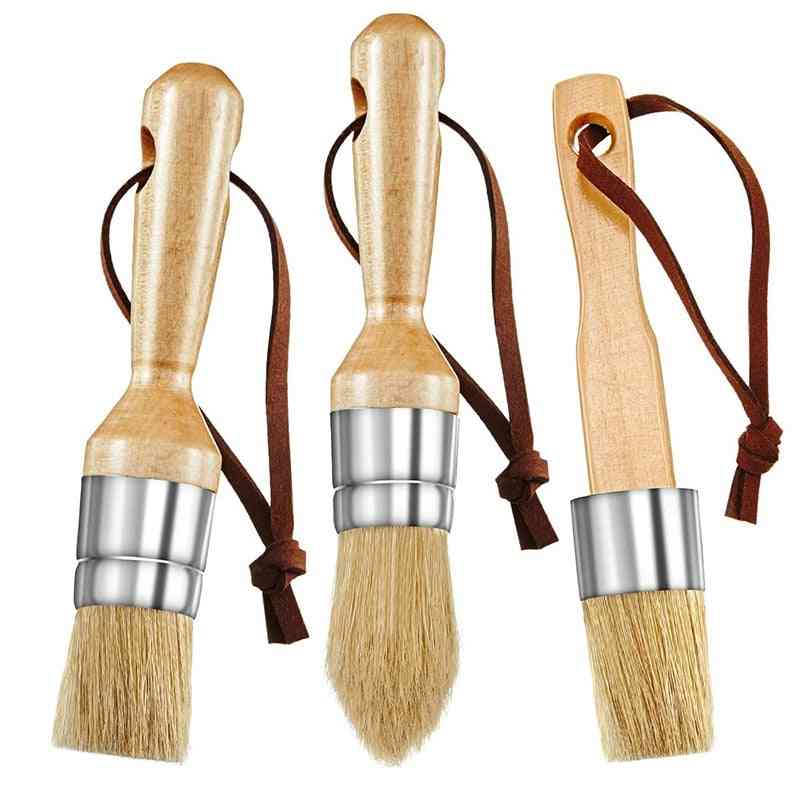Flat Pointed And Round Chalked Paint Brushes